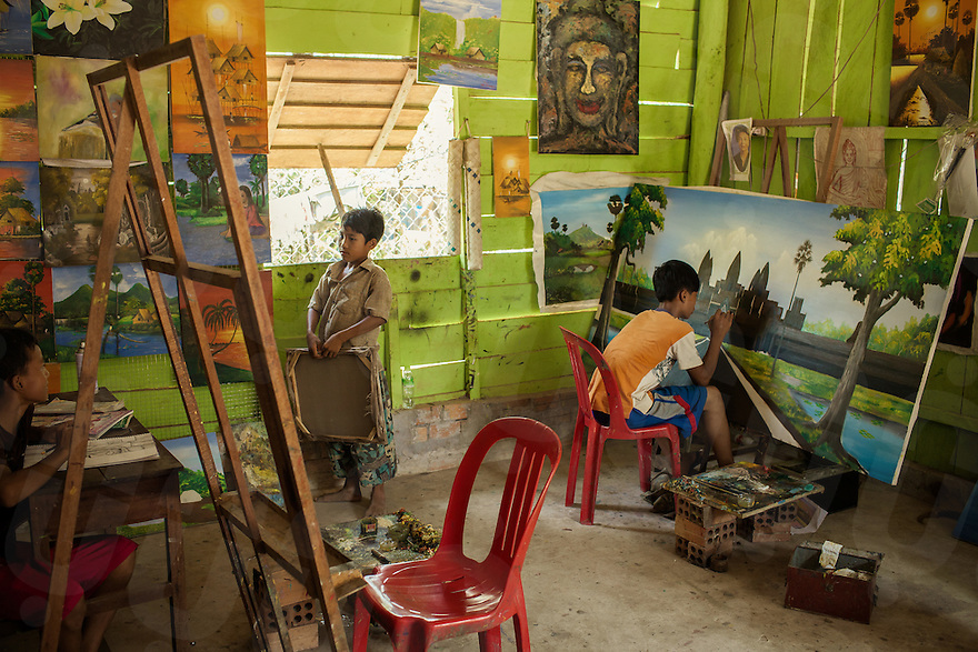 04/04/2013 - Siem Reap (Cambodia). Kids from an orphanage built inside the Angkor park, put the finishing touches to paintings to sell to tourists. © Thomas Cristofoletti 2013