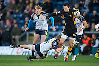 Tommy Bell of London Wasps is tackled by Jake Abbott of Worcester Warriors during the LV= Cup second round match between London Wasps and Worcester Warriors at Adams Park on Sunday 18th November 2012 (Photo by Rob Munro)