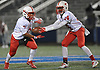 Gregory Pimentel #7 of Freeport, left, takes a handoff from quarterback Terrance Edmond #14 during the Nassau County Conference I varsity football semifinals against Massapequa at Hofstra University on Saturday, Nov. 11, 2017. Freeport won by a score of 33-13.