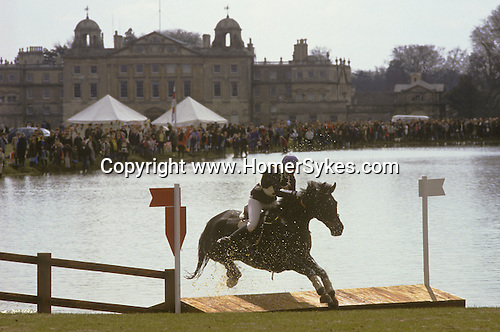 Badminton Horse Trials the water jump infront of Badminton House.   The English Season published by Pavilon Books 1987