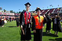 Alex Cousland and Kyle Meyers participate in the traditional Wacky Walk at Stanford Stadium during 122nd Commencement program on Sunday, June 16, 2013.