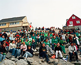 GREENLAND, Ilulissat, crowd watching football with houses in the background