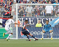 New England Revolution midfielder Diego Fagundez (14) scoring. In a Major League Soccer (MLS) match, the New England Revolution (blue) defeated LA Galaxy (white), 5-0, at Gillette Stadium on June 2, 2013.