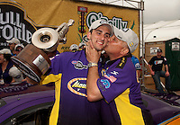 May 1, 2011; Baytown, TX, USA: NHRA pro stock driver Vincent Nobile (left) is kissed by father John Nobile after winning the Spring Nationals at Royal Purple Raceway. Mandatory Credit: Mark J. Rebilas-