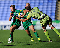 Calum Clark of Northampton Saints grabs out at Andrew Fenby of London Irish during the Premiership Rugby match between London Irish and Northampton Saints at the Madejski Stadium on Saturday 4th October 2014 (Photo by Rob Munro)