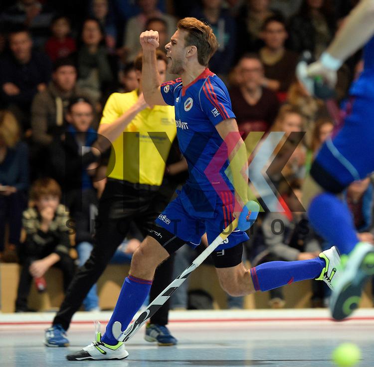 GER - Mannheim, Germany, December 12: During the 1. Bundesliga Sued Herren indoor hockey match between Mannheimer HC (blue) and TSV Mannheim (red) on December 12, 2015 at Irma-Roechling-Halle in Mannheim, Germany. Final score 5-0 (HT 1-0). Florian Woesch #25 of Mannheimer HC<br /> <br /> Foto &copy; PIX-Sportfotos *** Foto ist honorarpflichtig! *** Auf Anfrage in hoeherer Qualitaet/Aufloesung. Belegexemplar erbeten. Veroeffentlichung ausschliesslich fuer journalistisch-publizistische Zwecke. For editorial use only.