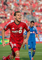 July 3, 2013: Toronto FC forward Jeremy Brockie #22 celebrates his goal during an MLS game between Toronto FC and Montreal Impact at BMO Field in Toronto, Ontario Canada.<br /> The game ended in a 3-3 draw.