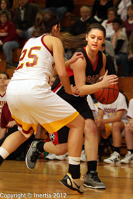 SIOUX FALLS, SD - FEBRUARY 27:  Amelia Miller #31 from Brookings tries to get a step past Anja Cucak #25 from Roosevelt in the first half of their District 1AA game Monday night at Roosevelt. (Photo by Dave Eggen/Inertia)