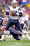 New England Patriots quarterback Tom Brady looks to make a pass against the Buffalo Bills at Ralph Wilson Stadium in Orchard Park, NY, on December 11, 2005 . The Patriots defeated the Bills 35-7. Mandatory Photo Credit: Ed Wolfstein