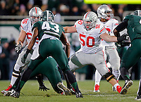 Ohio State Buckeyes offensive lineman Pat Elflein (65) and Ohio State Buckeyes offensive lineman Jacoby Boren (50) against Michigan State Spartans at Spartan Stadium in East Lansing, Michigan on November 8, 2014.  (Dispatch photo by Kyle Robertson)