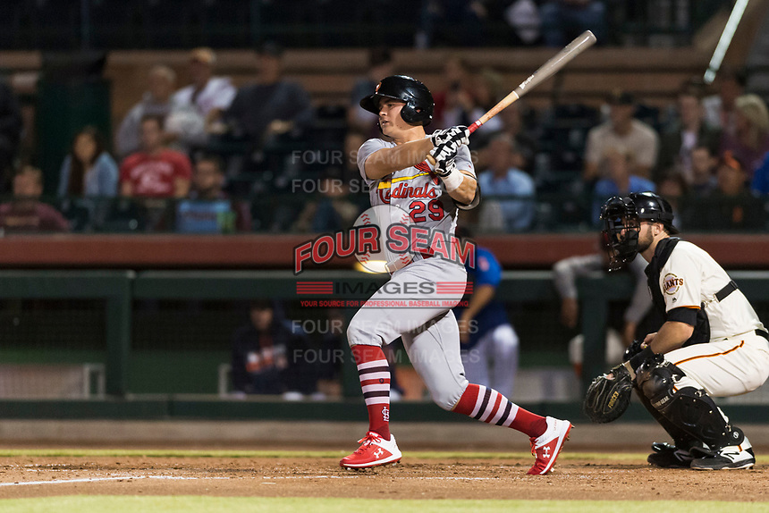 Surprise Saguaros second baseman Andy Young (29), of the St. Louis Cardinals organization, follows through on his swing in front of catcher Matt Winn (16) during an Arizona Fall League game against the Scottsdale Scorpions at Scottsdale Stadium on October 15, 2018 in Scottsdale, Arizona. Surprise defeated Scottsdale 2-0. (Zachary Lucy/Four Seam Images)