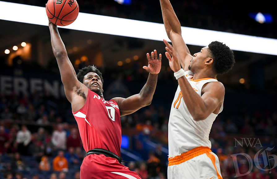 NWA Democrat-Gazette/CHARLIE KAIJO Arkansas Razorbacks guard Jaylen Barford (0) reaches for a layup as Tennessee Volunteers forward Kyle Alexander (11)  covers during the Southeastern Conference Men's Basketball Tournament semifinals, Saturday, March 10, 2018 at Scottrade Center in St. Louis, Mo. The Tennessee Volunteers knocked off the Arkansas Razorbacks 84-66