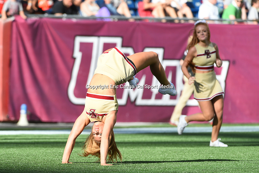 August 30, 2014 - Foxborough, Massachusetts, U.S. - A Boston College Eagles cheerleader does flips in the endzone after the team scored a touchdown during the NCAA Division I football game between Boston College Eagles and the University of Massachusetts Minutemen held at Gillette Stadium in Foxborough Massachusetts.  Boston College defeated The Minutemen 30-7. Eric Canha/CSM