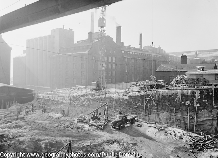 Construction site of new printing factory Helsinki, Uusimaa, Finland old bakery in background 1956