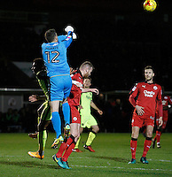 Crawley Town's Glenn Morris punches clear during the Sky Bet League 2 match between Crawley Town and Exeter City at Broadfield Stadium, Crawley, England on 28 February 2017. Photo by Carlton Myrie / PRiME Media Images.