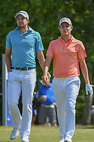 Peter Uihlein (USA) and Emiliano Grillo (ARG) head down 18 during Round 2 of the Zurich Classic of New Orl, TPC Louisiana, Avondale, Louisiana, USA. 4/27/2018.<br /> Picture: Golffile | Ken Murray<br /> <br /> <br /> All photo usage must carry mandatory copyright credit (&copy; Golffile | Ken Murray)