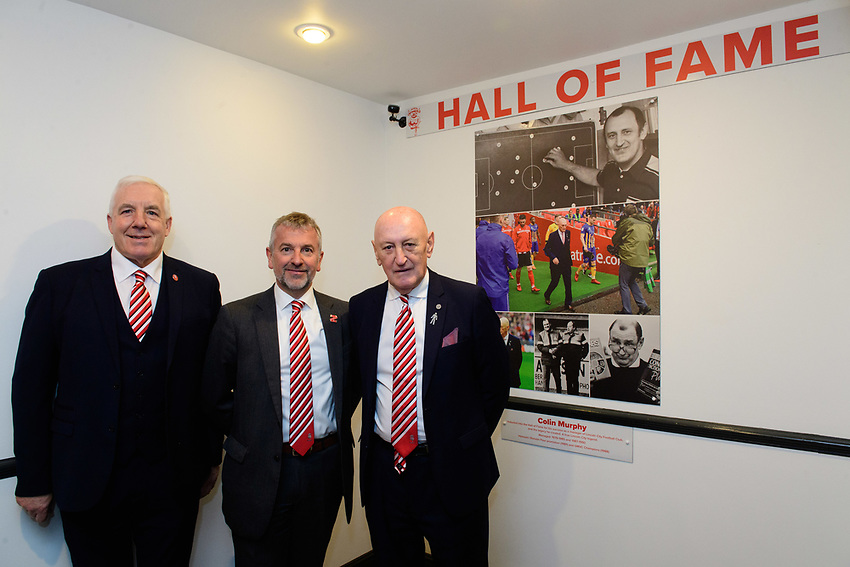 Lincoln City have inducted former manager Colin Murphy as the inaugural member of their Hall of Fame. Picutred is, from left, Lincoln City Former Players Association chairman Trevor Swinburne, Lincoln City's vice-chairman Roger Bates, left, and Colin Murphy.<br /> <br /> Photographer Chris Vaughan/CameraSport<br /> <br /> The EFL Sky Bet League Two - Saturday 15th December 2018 - Lincoln City v Morecambe - Sincil Bank - Lincoln<br /> <br /> World Copyright © 2018 CameraSport. All rights reserved. 43 Linden Ave. Countesthorpe. Leicester. England. LE8 5PG - Tel: +44 (0) 116 277 4147 - admin@camerasport.com - www.camerasport.com