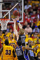 Kyle Singler of the Blue Devils has his shot challenged by Terrapins' Cliff Tucker. Maryland defeated Duke 79-72 at the Comcast Center in College Park, MD on Wednesday, March 3, 2010. Alan P. Santos/DC Sports Box