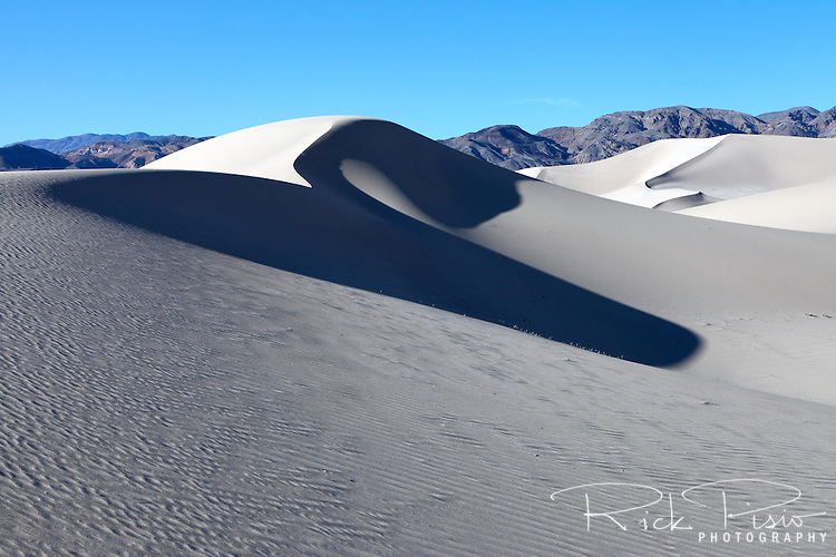 The sands of 680 foot tall Eureka Dunes in Death Valley National Park.