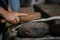 Kapa making on the Big Island: First beating of wauke (mulberry tree) bast with a hohoa (round wooden mallet or beater) on a kua pohaku (stone anvil); the final product will be kapa (bark cloth).