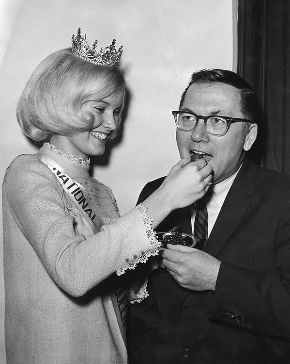 UNITED STATES: Senator Robert Griffin is pictured with the 1967 Michigan National Cherry Queen, Julie Ann Hamilton. Sen. Robert Griffin died on April 17, 2015. (CQ Roll Call File Photo)