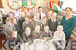 TEACHER: Pupils of Curraheen NS in Glenbeigh with their teacher, Muireann O'Donovan, who faces losing her job due to education cutbacks.