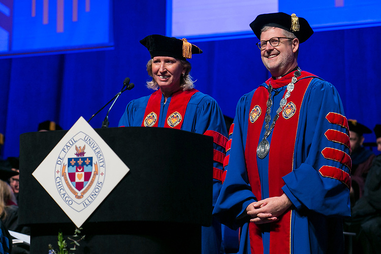 Honorary degree recipient Marty Wilke, broadcast television executive and DePaul alumna, with the Rev. Dennis H. Holtschneider, C.M., president of DePaul, Sunday, June 11, 2017, during the DePaul University College of Computing and Digital Media and the College of Communication commencement ceremony at the Allstate Arena in Rosemont, IL. (DePaul University/Jamie Moncrief)