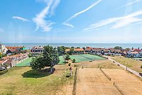 BNPS.co.uk (01202 558833)<br /> Pic: Savills/BNPS<br /> <br /> Views to the Suffolk coast.<br /> <br /> Water View...Former water tower near Aldeburgh in Suffolk<br /> <br /> A huge six storey former water tower which resembles a castle gate house has emerged on to the market for £1million.<br /> <br /> Grade II listed West Bar, in Thorpeness, provides the perfect vantage point to take in breathtaking views of the Suffolk coast.<br /> <br /> It was designed by architect William Gilmour Wilson in the 1920s in a mock tudor style, with mullioned windows and parapets.<br /> <br /> The six storey, five bedroom property, boasting distinctive full length windows and open fireplaces, has two spacious 'tower' rooms.<br /> <br /> The water tanks were taken out by the deceased owner about 20 years ago. It is being sold with estate agent Savills by his children.