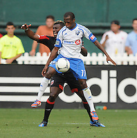 Montreal Impact forward Sanna Nyassi (11) shields the ball from D.C. United defender Brandon McDonald (4) D.C. United defeated Montreal Impact 3-0 at RFK Stadium, Saturday June 30, 2012.