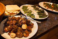 "SEATTLE, WA-APRIL 17, 2017: Rosemary potatoes, Matzah, Asparagus with yogurt and orange sauce and Salmon Horseradish with caramelized onions were among the dishes served during the dinner party. <br /> <br /> Amanda Saab, along with her husband Hussein Saab, host a ""dinner with your Muslim neighbor"" at the home of Stefanie and Nason (cq) Fox in Seattle, WA on a return trip April 17th 2017. The couple now live in Detroit.<br /> (Photo by Meryl Schenker/For The Washington Post)"