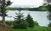 View across a peaceful lake in the Adirondack mountains