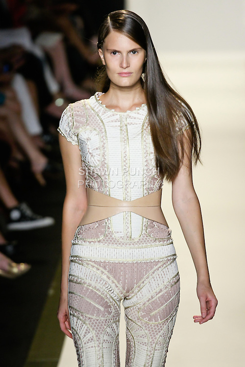 Alla walks runway in an outfit from the Hervé Léger by Max Azria Spring 2013 collection during Mercedes-Benz Fashion Week, in New York, September 8, 2012.