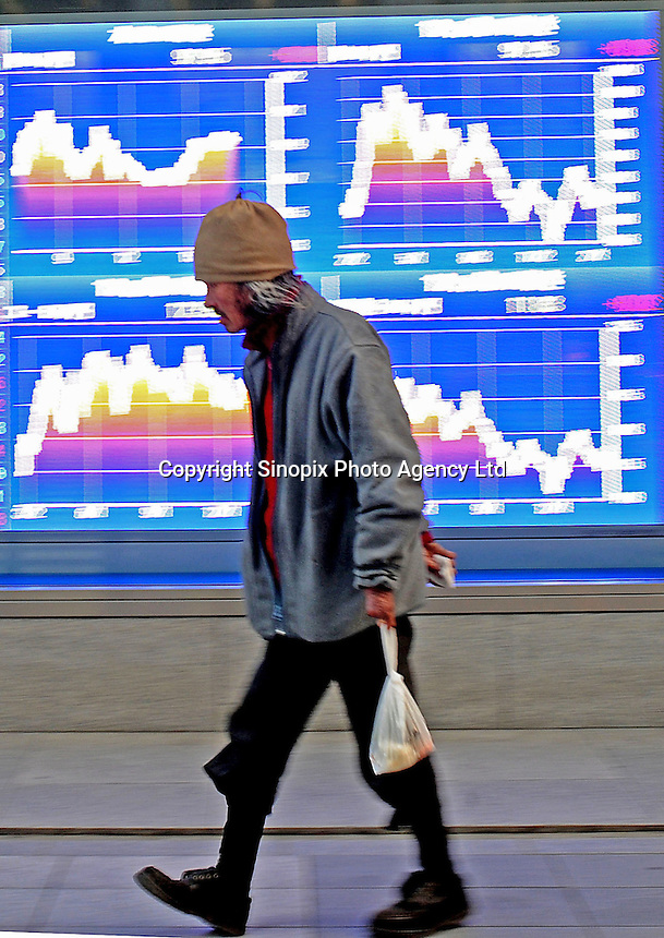 A homeless man passes a Stock Exchange Screen board in Tokyo, Japan. Japan's stock falls mirrored similar activity in the stock market's of other nations, with Hong Kong, Singapore and South Korea also seeing drops..
