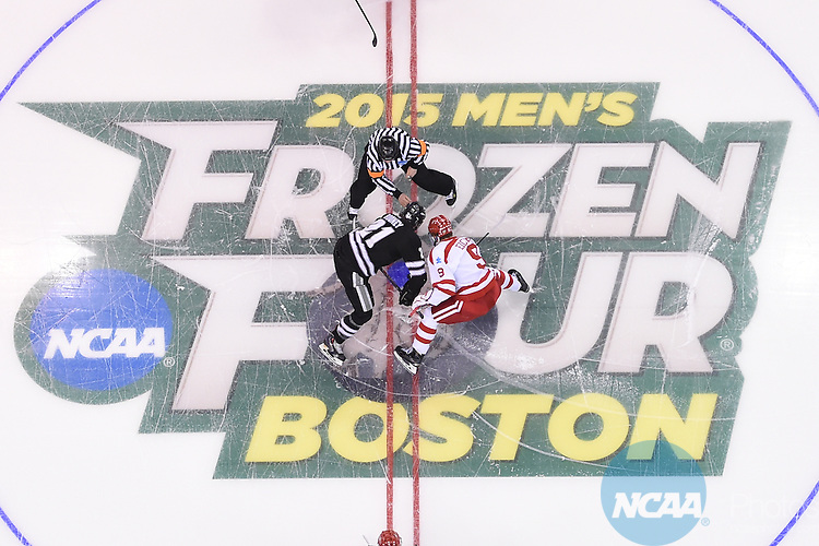 11 APR 2015: Jack Eichel (9) of Boston University faces off against Kevin Rooney (21) of Providence College during the Division I Men's Ice Hockey Championship held at the TD Garden in Boston, MA. Providence defeated Boston 4-3 for the national title. Brian Babineau/NCAA Photos