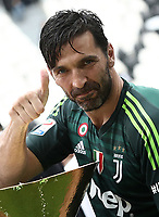 Calcio, Serie A: Juventus - Hellas Verona, Torino, Allianz Stadium, 19 maggio, 2018.<br /> Juventus' Captain and goalkeeper Gianluigi Buffon celebrates with the trophy during the victory ceremony following the Italian Serie A football match between Juventus and Hellas Verona at Torino's Allianz stadium, 19 May, 2018.<br /> Juventus won their 34th Serie A title (scudetto) and seventh in succession.<br /> Gianluigi Buffon played his last match with Juventus today after 17 years.<br /> UPDATE IMAGES PRESS/Isabella Bonotto