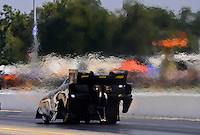 Sept. 15, 2012; Concord, NC, USA: Heat waves come from the car of NHRA funny car driver Bob Gilbertson during qualifying for the O'Reilly Auto Parts Nationals at zMax Dragway. Mandatory Credit: Mark J. Rebilas-