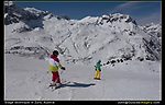 Austria, St Anton.  Stage Technique.<br /> Make a nice composition or 'stage' and let the skiers pass by. Don't move the camera. Make 4-5 exposures, then choose the best composition. Repeat.