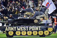 Baltimore, MD - DEC 10, 2016: Army fans storm the field after defeating Navy 21-17 ending a 14 year win streak against the Knights at M&T Bank Stadium, Baltimore, MD. (Photo by Phil Peters/Media Images International)