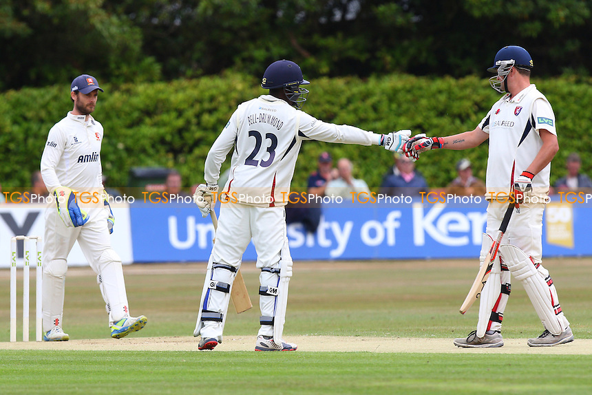 Rob Key of Kent (R) congratulates Daniel Bell-Drummond on reaching his fifty