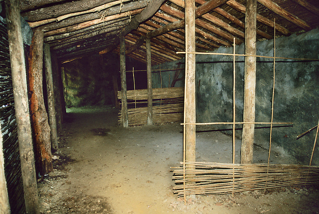 Interior of traditional Cherokee winter house constructed from wattle and daub and logs. Located at the Cherokee National Museum in Tahlequay OK