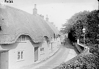 BNPS.co.uk (01202 558833)<br /> Pic: ShaftesburyHistoricalSociety/BNPS<br /> <br /> Pictured: Thatch cottages on Angel Lane at the turn of the 20th century.<br /> <br /> These charming photos reveal everyday life at the turn of the 20th century in a thriving market town later made famous by a TV advert.<br /> <br /> The black and white snapshots of Shaftesbury, Dorset, were taken by Albert Tyler who set up a photography business there in 1901.<br /> <br /> There are various street scenes and also images of the locals in traditional attire, with men in flatcaps and women in bonnets.<br /> <br /> Tyler photographed the busy opening of the town market in 1902, and a garden party where men played croquet.