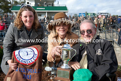 Tax Ruling's trainer, Brianne Slater, and owners Diane and Irv Naylor.
