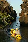 Kayaking below a Candel cactus on a cliff  on Santa Cruz island<br /> sur l Ile de Santa Cruz on peut faire du kayak au pied des falaises et des cactus geants de  Punta estrada a deux pas de la ville de Puerto Ayora