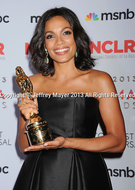 PASADENA, CA- SEPTEMBER 27: Actress Rosario Dawson poses in the press room at the 2013 NCLA ALMA Awards at Pasadena Civic Auditorium on September 27, 2013 in Pasadena, California.