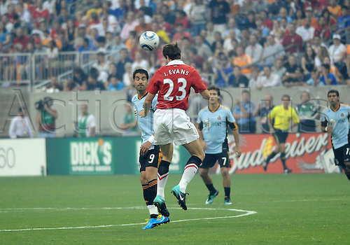 28 July 2010: Juan Pablo Angel (9) of the MLS All-Stars and Jonny Evans (23) of Manchester United  fight for the ball in the first period of  the MLS All-Star game. Manchester United defeated the MLS All-Stars 5-2 at Reliant Stadium in Houston, TX