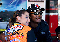 Sept. 21, 2013; Ennis, TX, USA: NHRA top fuel dragster driver Antron Brown poses with a fan during the Fall Nationals at the Texas Motorplex. Mandatory Credit: Mark J. Rebilas-