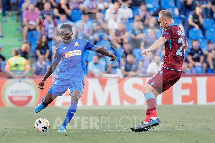Djene Dakoman of Getafe CF and Dogan Erdogan of Trabzonspor during UEFA Europa League match between Getafe CF and Trabzonspor at Coliseum Alfonso Perez in Getafe, Spain. September 19, 2019. (ALTERPHOTOS/A. Perez Meca)