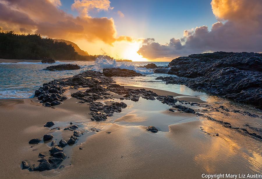Kauai, H:I Sunset from Lumaha'i Beach with colors of the sky reflecting on the surf and sand beach