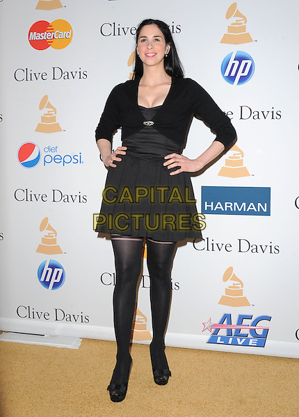 SARAH SILVERMAN .attends the Annual Clive Davis & The Recording Company Pre-Grammy Gala - Salute To Icons held At The Beverly Hilton Hotel, Beverly Hills, California, USA, 12th February 2011..full length black dress cardigan hands on hips tights platform peep toe shoes bows stockings .CAP/RKE/DVS.©DVS/RockinExposures/Capital Pictures.