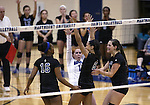 The Marymount Saints celebrate a Cailyn Thomas block in a college volleyball game, in Arlington, Vir., on Saturday, Nov. 1, 2014.<br /> Photo by Cathleen Allison